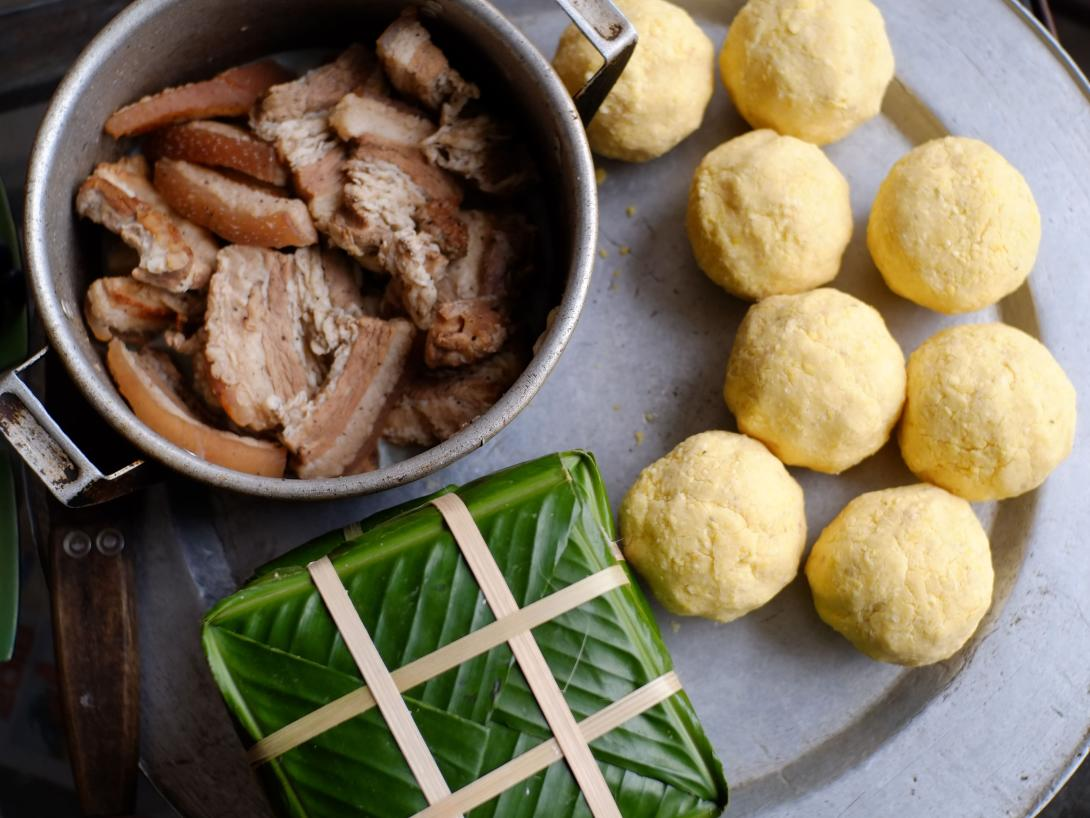 Travellers learn to cook sticky rice cakes - a traditional lunar new year dish in Vietnam.